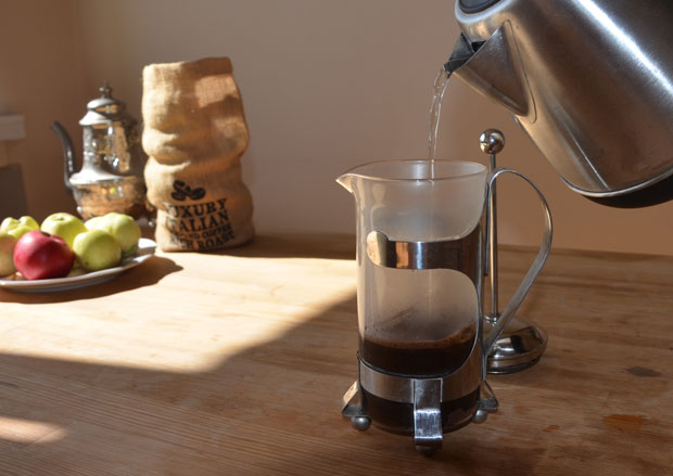 Pouring hot water into a French press